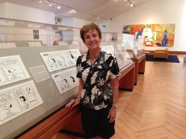 Jean Schulz in the Strip Gallery showing the enlarged cartoon images